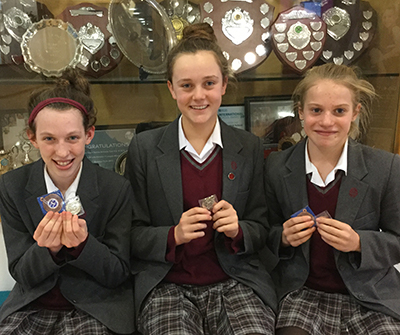 Pictured below Lilly-Marie Derry, Evelyn Davis, and Annabel Smith with their medals